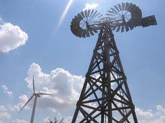 American Wind Power Center. Modern wind turbine and rare twin windmill.