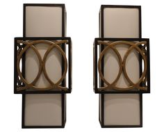 Pair of 2 light dark bronze and gold steel Art Deco style ambient light sconces with white matte silk shades.  Designed to cast a soft light over a wide area. No modifications, updates, or repairs necessary.  Wiring is updated, new shades, and backplates are included. Fixture takes max 13 watt bulbs, UL listed GU24 S8FL only.   Bulbs are 120v, 60hz, 13w warm white fluorescent and included with fixture.   3 pair available, and in excellent condition, and if requested, will send photo before…