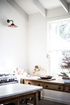 mix of old furniture and new, against white walls and big windows