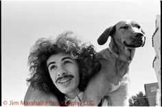 Carlos Santana and canine pal (Grateful Dead concert, San Francisco c.1968)