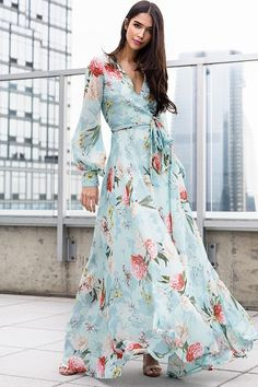 Meet the flowing silhouette of our Giselle Blue Floral Maxi Dress. Details include attached belt, a wrap bodice, buttons on cuff, snap closure on neckline, and hidden back zipper. Maxi Wrap Dress, Floral Maxi Dress, Belted Dress, Dress Skirt, Floral Frocks, Floral Print Gowns, Floral Prints, Sheath Dress, Elegant Dresses