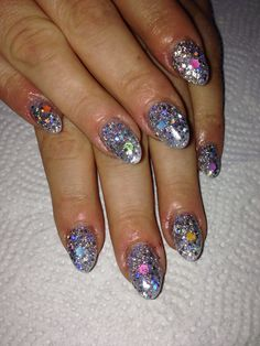 Silver glitter acrylic nails.