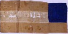 """13-star First National pattern miniature flag made by Amanda Stone Bowen of Missouri in 1861. She reportedly concealed the flag on her person during repeated searches by Federals in her Missouri home. 7"""" x 14"""" Museum of the Confederacy Collection."""