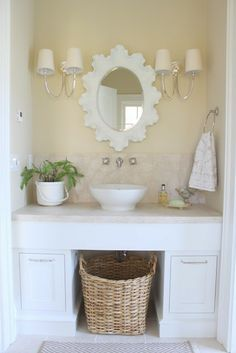 Love the basket underneath the sink - that space is usually wasted. Could use it as a hamper or just put some rolled up towels in it for color