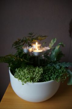 plant some plants in a pottery you like, and put glass candles in.