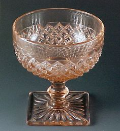 Miss America Pink Depression Glass Sherbet: A very popular depression glass pattern. Raised diamond pattern with an Art Deco square foot. Hocking Glass made Miss America from 1935 to 1938, after Art Deco left the high fashion stage. In the 1930s,, fashions reached the mainstream after the style peaked in the high end galleries.