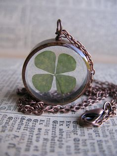 Lucky 4 Leaf Clover Pendant - Real 4 leaf clover encased in resin with clear copper bezel. $10.00, via Etsy.
