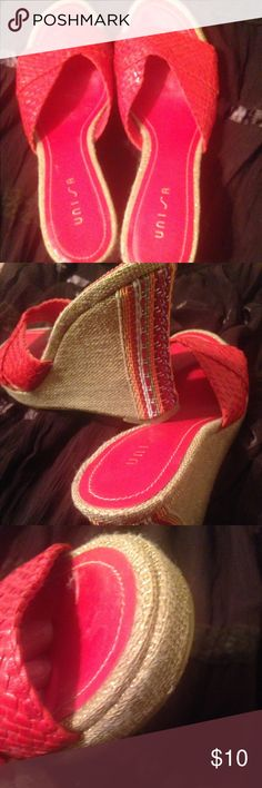 Red Wedge sandal with very multi color on heel. Unisa red wedges with multi thread design dressing up heel. Can be casual or dressy! Worn twice to summer indoor parties. Unisa Shoes Wedges