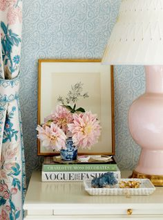 Ashley Whitaker Design - love the soft pink lamp against the blue wallpaper, with gold accents and a small chinoiserie vase.