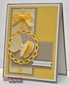 beautiful card...luv the small pearls on the die cut, perfect bow, pleasing colors, good layout...
