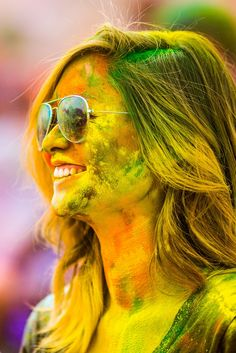 The series of images depict all of the fun and madness at the 2012 festival where hordes of people took part it in the jovial community activity. Adults and children alike joined in on the good time, resulting in a welcoming multicolored mess. Hawk's shots of these people with wide, open-mouth smiles are infectious and you can't help but smile along with them.