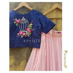 Blue raw silk crop top with floral embroidery and net ruffled skirt and dupatta. For more information Whatsapp on Blouse Back Neck Designs, Fancy Blouse Designs, Bridal Blouse Designs, Designs For Dresses, Hand Embroidery Dress, Embroidery Fashion, Embroidered Blouse, Embroidery Patterns, Kerala Saree Blouse Designs