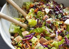 This salad is delicious to eat, beautiful to behold, and very healthful. It combines the crunch of red cabbage, carrots, succulent romaine hearts, crispy apples, and almonds—all complemented by sweet-tart dried cranberries and an agave-Dijon vinaigrette.—Myra Goodman, co-author ofStraight from the Earth Serves 6 For the Agave -Dijon Vinaigrette: ½ cup/120 ml extra-virgin olive
