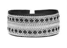 Ewa Roslin --  Pewter bracelet of reindeer skin, pewter thread and reindeer antler buttons.