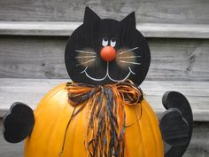 Wooden Cat that goes in a Pumpkin. $15.00, via Etsy.