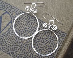 We added our own twist to the basic hoop earring, handformed and hammered with 18 gauge sterling silver wire. Light weight and elegant, simple