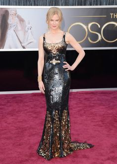 #Oscars #RedCarpet #NicoleKidman  Still think I keep seeing a gold sequined BATMAN logo in the middle!