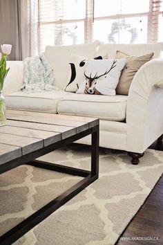 white living room couch dark wood floor trellis rug