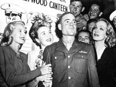 dress-for-excess:  Lana Turner, Deanna Durbin and Marlene Dietrich doing their bit for their boys during WW2 at the marvellous Hollywood Canteen. I salute you all gals.