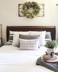 An out of the box idea for above the bed; hang an old wire bed spring with a wreath!