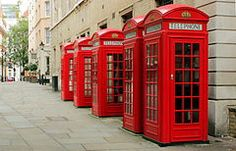 red telephone boxes in Covent Garden, London, England - these are disappearing though they can still be found in the tourist parts of London