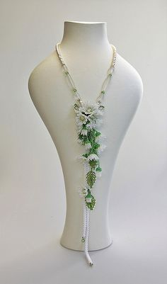 A flower beaded necklace with freshwater pearls. The focal flowers are embroidered with japanese seed beads. It is stranded with freshwater pearls and measures 20 inches in total length. A stunning necklace suited for any special event Cascading Flowers, Beaded Flowers, Bridal Necklace, Lariat Necklace, Custom Jewelry, Handmade Jewelry, Seed Bead Flowers, Seed Beads, Wraps