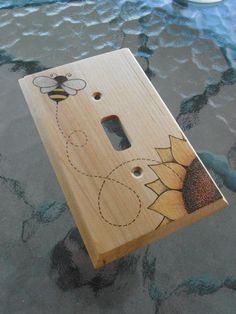 Bumblebee and Flower Woodburned Switchplate / Light Switch Cover / Wallplate by WileWood on Etsy https://www.etsy.com/listing/201195559/bumblebee-and-flower-woodburned