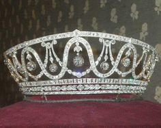 CROWN~The diamond tiara belonged to Grand Duchess Hilda (1864-1952), the daughter of the Grand Duke of Luxembourg. Schmidt Staub designed this tiara in 1906/1907. It was possibly made as a kokoshnik of garland style. These interconnecting bands are hanging eleven, graduated diamonds of a total of 15 ct. The largest of them weighs approximately 5 ct. Additionally, the tiara is set with 457 old cut and 225 single cut diamonds totaling approximately 75 ct and mounted in gold and plutinam.