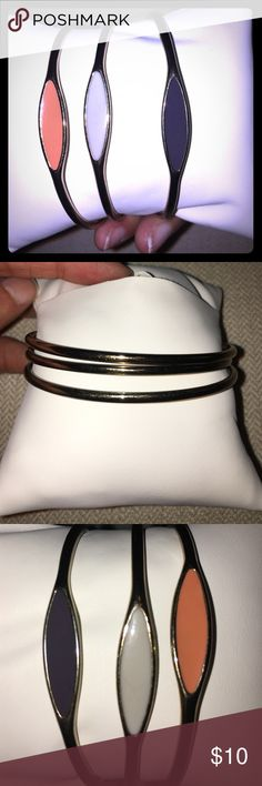 Set of 3 Bangles Purple, pink, and a light gray bangle. This set is very cute and great for layering! Jewelry Bracelets