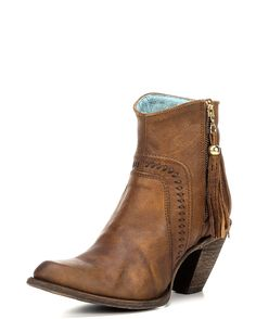 <p>Bring some stylish flavor to your outfit by wearing these uniquely-designed women's ankle boots. Handcrafted in chedron leather, these boots stand out in much fashionable flair with a side zipper on each boot, with tassel, making for easier dressing and braided details. Soft lining and cushioned insoles provides much comfort for long wear. Leather outsoles make for confident strides when walking. Complementary to most outfits in any season, these are fabulous must haves!</p><p>Corra...