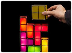 The BEST list for geeky gift ideas. Seriously, if you have even an ounce of geek in you, you need to check this out. (Tetris Desk Lamp pictured)