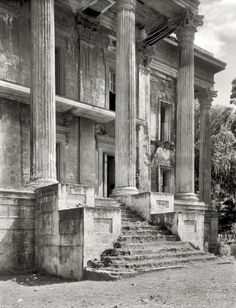 "1938. Iberville Parish, Louisiana. ""Belle Grove. Vicinity of White Castle. Greek Revival mansion of 75 rooms. Ruinous condition. Built 1857 by John Andrews, who sold it to Stone Ware. Occupied by Ware family until circa 1913."" The decaying portico of what was reputedly the largest plantation home in the South. 8x10 inch safety negative by Frances Benjamin Johnston."