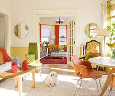 A cheerful color scheme brightens this cozy living room. More living room design ideas: http://www.bhg.com/rooms/living-room/makeovers/living-room-decorating-ideas/?socsrc=bhgpin052313orangegreenlivingroom=8