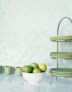 Just love quatrefoil tile..what a gorgeous backsplash!