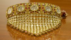Fit for a maharaja or a bride from a wealthy family, this 23K gold necklace is set with flat uncut polki diamonds. Courtesy Surana Jewellers.
