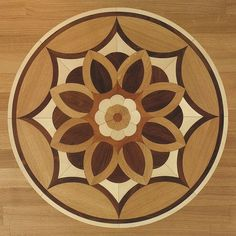 A floral theme this time for a centrepiece created with inlaid woods of different colours. Flooring by Element 7.  www.element7.co.uk Wooden Pattern, Pattern Art, Bois Intarsia, Wood Projects, Woodworking Projects, Parquetry Floor, Installing Hardwood Floors, Foto Transfer, Floor Patterns