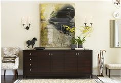 Clutter-Free Storage - Sarah [Richardson] added a sideboard to corral items big and small. Love the vignette - sideboard + Tang horse, sconces, artwork. Sarah Richardson, Transitional Living Rooms, Transitional House, Suburban House, Chandelier, Layout, Mid Century House, Console Table, Family Room