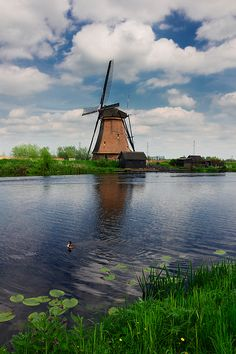 #AnastasyYarmolovichFineArtPhotography  #ArtForHome #Holland #Netherlands Dutch windmills reflecting in river at summer day, Kinderdijk, Holland by Anastasy Yarmolovich