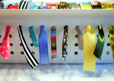 Brilliant ribbon storage idea. Must buy many bins for my ribbon collection.