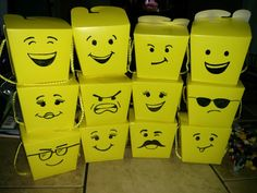 Party favor boxes from the dollar store with Lego faces drawn on!