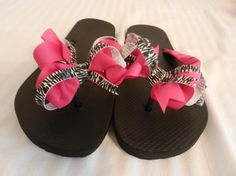 Fabulous Flops. These are black flip flops with hot pink and zebra bows. The straps have been wrapped with hot pink ribbon. They are simply fabulous. You may choose any color, any size, and any bow. $20.00 email orders to allthatglitters0908@gmail.com