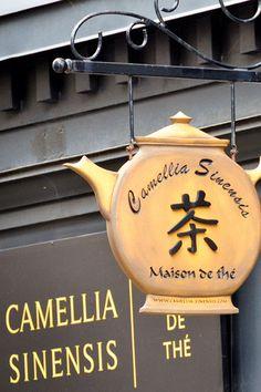 teapot-shaped sign outside Camellia Sinensis Maison de the [Tea House], in Montreal, Quebec, Canada