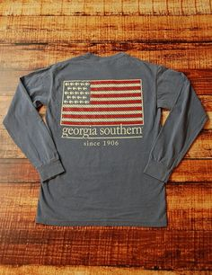 While showing your school spirit on game day you can show your love for your country as well With this long-sleeve Comfort Color Georgia Southern Flag t-shirt you can do just that Go GSU Eagles