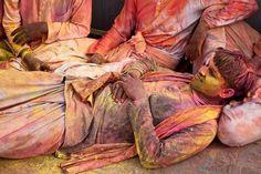 Celebrant resting during Holi festival in Lathmar, India