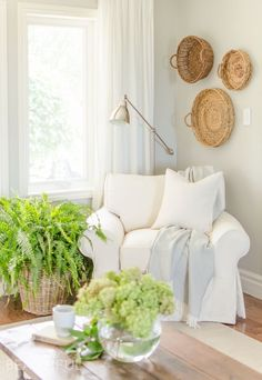 A white slipcovered sofa looks casual and relaxed in this charming farmhouse…