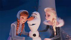 Anna, Olaf, and Elsa hug.
