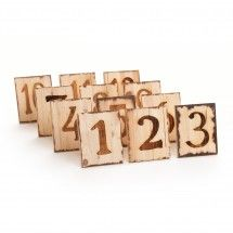 Natural Square Woodburned Table Numbers (Set of 12). These you could do yourself using wood scraps. You could also use them as house numbers too ;)