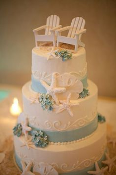 Beach wedding cake.  Nautical wedding cake. With the chairs topper could be an Anniversary or Retirement Party cake.