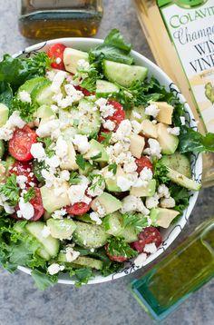 Chopped Greek Kale Salad with tomato, cucumber, avocado, and feta + a yummy homemade dressing!