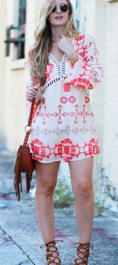 Bell sleeve bohemian summer dress styled with lace up block heel sandals, and fringe saddle bag for boho chic outfit